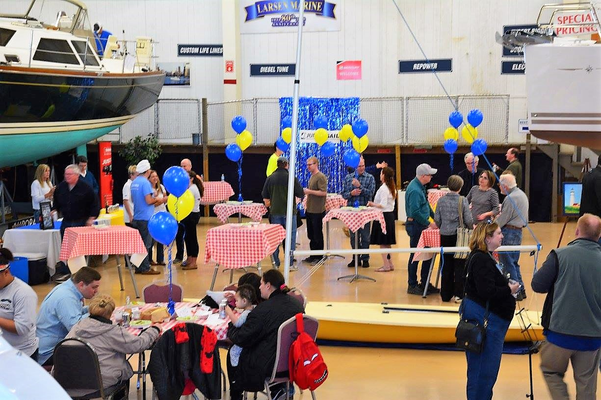 Last year's Annual WYC Junior Sail Spaghetti Dinner + Reunion also was held in the showroom of Larsen Marine Service.